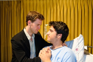 Roger (Tyson Coady) and Gordon (Andrew Cohen) share a hospital bedside moment