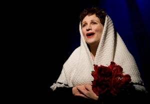 Naomi Emmerson as Edith Piaf in Piaf: Love Conquers All.  Photo by Larry Auerbach.