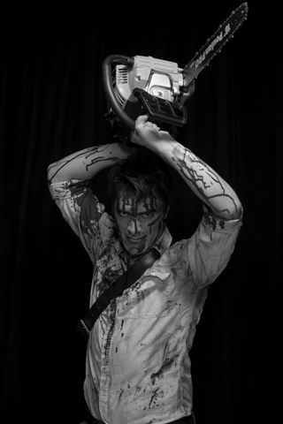 Scott Walters as Ash in Down Stage Right Production's Evil Dead: The Musical.
